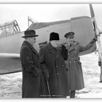 "British Prime Minister Winston Churchill visits BCATP training at Uplands, Ont., accompanied by Air Minister C.G. Power (left) and W/C W.R. MacBrian (right), in December 1941. Source : RCAF, ""The Aerodrome of Democracy"" (1940-1945)."